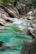 Drive or walk the scenic Soca Trail (So?ka pot) along the Soca River gorge, Trenta Valley, Triglav National Park (Triglavski narodni park, TNP), Slovenia, Europe. The crystal clear Soca retains an unusually beautiful emerald green color throughout its length. From 1915-1917, over 600,000 Austro-Hungarian and Italian soldiers lost their lives in the Soca River valley in twelve battles of the Isonzo on the Italian front in World War I. The Julian Alps (Slovene: Julijske Alpe, Italian: Alpi Giulie) stretch from north-eastern Italy to Slovenia in the Southern Limestone Alps. The namesake for the Julian Alps, Julius Caesar, founded the municipium of Cividale del Friuli at their foot.