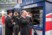 © Licensed to London News Pictures. 18/06/2014. Ascot, UK. Men buy binoculars.  Day two at Royal Ascot 18th June 2014. Royal Ascot has established itself as a national institution and the centrepiece of the British social calendar as well as being a stage for the best racehorses in the world. Photo credit : Stephen Simpson/LNP