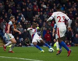Wilfried Zaha of Crystal Palace (C) scores his sides third goal - Mandatory by-line: Jack Phillips/JMP - 02/03/2019 - FOOTBALL - Turf Moor - Burnley, England - Burnley v Crystal Palace - English Premier League