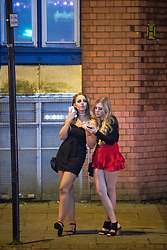 "© Licensed to London News Pictures . 16/12/2017. Manchester, UK. A woman leans on another women at Deansgate Locks . Revellers out in Manchester City Centre overnight during "" Mad Friday "" , named for historically being one of the busiest nights of the year for the emergency services in the UK . Photo credit: Joel Goodman/LNP"