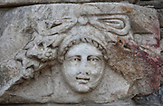 Mask and garland frieze from the Portico of Tiberius on the Southern portico of the Agora, 1st century AD, Aphrodisias, Aydin, Turkey. The Sculpture School at Aphrodisias was an important producer of carved marble sarcophagi and friezes from the 1st century BC until the 6th century AD. The Portico of Tiberius was built under the reign of Tiberius and has many examples of mask and garland friezes, consisting of the heads of gods, goddesses, theatrical characters, mythological figures or masks, each with a distinct facial expression, between hanging garlands of leaves, fruit and flowers. This example has a forlorn expression. Aphrodisias was a small ancient Greek city in Caria near the modern-day town of Geyre. It was named after Aphrodite, the Greek goddess of love, who had here her unique cult image, the Aphrodite of Aphrodisias. The city suffered major earthquakes in the 4th and 7th centuries which destroyed most of the ancient structures. Picture by Manuel Cohen