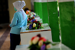 A woman stands near a coffin of victim of AirAsia Flight QZ8501 at a hospital in Pangkalan Bun, Indonesia. Jan. 4, 2015. An Indonesian pilot taking part in the multinational search operation said here on Sunday that three more bodies were found in AirAsia crash site off Borneo coast. EXPA Pictures © 2015, PhotoCredit: EXPA/ Photoshot/ Agung Kuncahya B.<br /> <br /> *****ATTENTION - for AUT, SLO, CRO, SRB, BIH, MAZ only*****