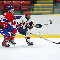 WELLINGTON, ON - DECEMBER 7: Jacob Vreugdenhill #16 of the Wellington Dukes and Cameron Fulop #18 of the Toronto Jr. Canadiens in the second period on December 7, 2018 at Wellington and District Community Centre in Wellington, Ontario, Canada.<br /> (Photo by Ed McPherson / OJHL Images)