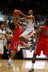 Feb 4, 2012; Stanford CA, USA;  Stanford Cardinal guard Jarrett Mann (22) shoots past Arizona Wildcats forward Jesse Perry (33) during the first half at Maples Pavilion.  Mandatory Credit: Jason O. Watson-US PRESSWIRE