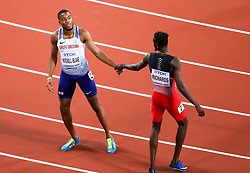 London, August 10 2017 . Nethaneel Mitchell-Blake, Great Britain, congratulates bronze winner Jereem Richards, Trinidad and Tobago, at the finish of the men's 200m final on day seven of the IAAF London 2017 world Championships at the London Stadium. © Paul Davey.