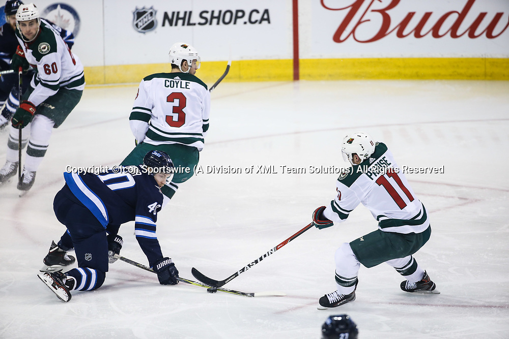 WINNIPEG, MB – April 11: Winnipeg Jets forward Joel Armia (40) checks Minnesota Wild forward Zach Parise (11) during the Stanley Cup Playoffs First Round Game 1 between the Winnipeg Jets and the Minnesota Wild on April 11, 2018 at the Bell MTS Place in Winnipeg MB. (Photo by Terrence Lee/Icon Sportswire)