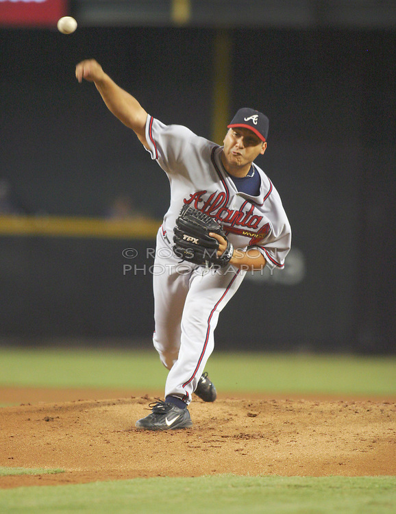 Phoenix,AZ 08-08-04  Atlanta Braves' Russ Ortiz throws in the first inning against the Arizona Diamondbacks. Ortiz pitched 5 2/3 innings with 7 hits and 3 runs. The Braves won 11-4. Ross Mason photo