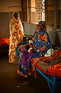 A woman holds her day old, unnamed baby, who was born with spina bifida in a free clinic near Goz Beida, in eastern Chad. Her doctor said that the baby would likely die from the condition.