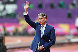 London, 2017-August-04. Lord Sebastian Coe waves at the crowd after presenting reallocated medals at the IAAF World Championships London 2017. Paul Davey.