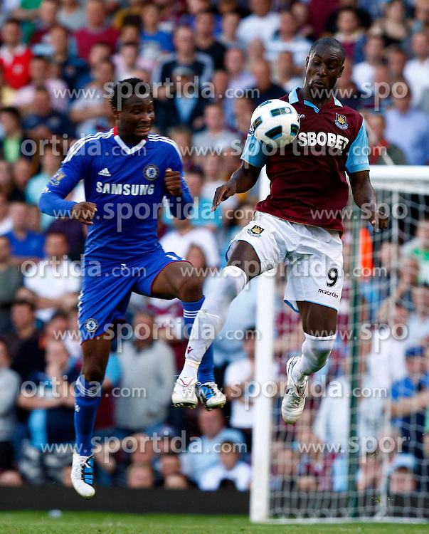 11.09.2010, Boleyn Ground Upton Park, London, ENG, PL, West Ham United vs FC Chelsea, im Bild Carlton Cole of West Ham United beats Chelsea's Nigerian footballer John Mikel Obi  Barclays Premier League West Ham United v Chelsea.at Boleyn Ground Upton Park. EXPA Pictures © 2010, PhotoCredit: EXPA/ IPS/ Kieran Galvin +++++ ATTENTION - OUT OF ENGLAND/UK +++++ / SPORTIDA PHOTO AGENCY