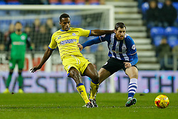 Jose Semedo of Sheffield Wednesday is challenged by Chris McCann of Wigan - Photo mandatory by-line: Rogan Thomson/JMP - 07966 386802 - 30/12/2014 - SPORT - FOOTBALL - Wigan, England - DW Stadium - Wigan Athletic v Sheffield Wednesday - Sky Bet Championship.
