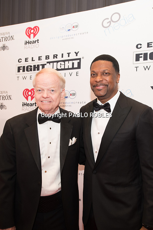 Jimmy Walker and Chris Tucker attend the Celebrity Fight Night event on March 23, 2019 in Scottsdale, AZ.