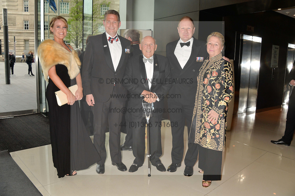 Left to right, CHARLIE GREER, MAJOR JAMES CAMERON, SIR STIRLING MOSS, BRIG.MIKE HICKSON (RETIRED) and LADY MOSS at the Soldiering On Awards held at the Park Plaza Hotel, Westminster Bridge, London on 5th April 2014.