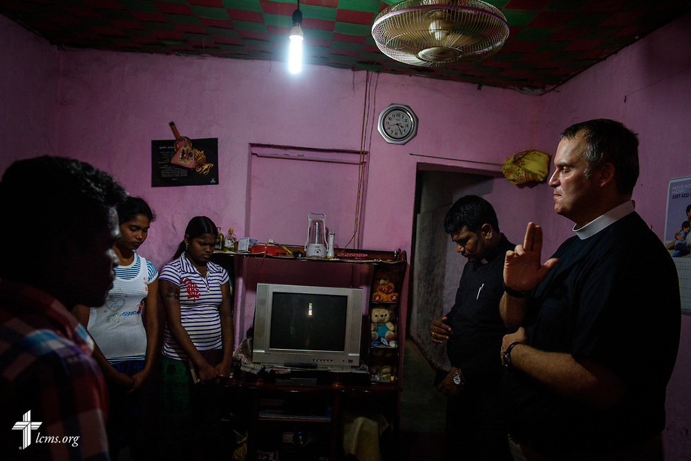 Church members in a home on the Eila rubber plantation in the Sabaragamuwa Province of Sri Lanka pray with their pastor, the Rev. P. Gnanakumar, and the Rev. Steven Mahlburg, LCMS career missionary to Sri Lanka, during a visitation on Saturday, Jan. 20, 2018. LCMS Communications/ Erik M. Lunsford