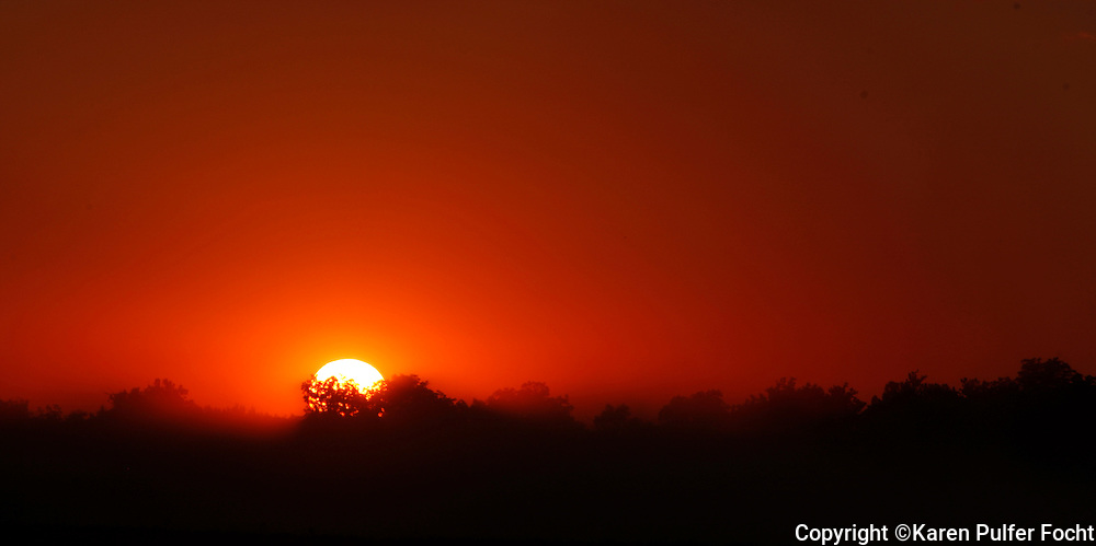 Smoke settles over a field as the sun sets in Clarksdale, Mississippi.