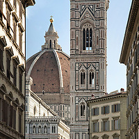 Tower and Dome of Florence's Santa Maria del Fiore church, a famous landmark and tourist attraction. Here in the midst of typical 18th century buildings in the old city center of the tuscan capital. A lightning protection pole on the tower roof has been removed from the original picture in Photoshop.