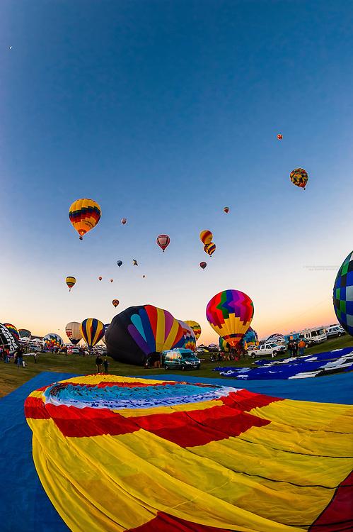Hot air balloons being inflated, Albuquerque International Balloon Fiesta, Albuquerque, New Mexico USA.