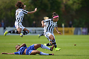 Chelsea Ladies midfielder Drew Spence slides in to tackle Notts County Ladies forward Jess Clarke during the FA Women's Super League match between Chelsea Ladies FC and Notts County Ladies FC at Staines Town FC, Staines, United Kingdom on 6 September 2015. Photo by Mark Davies.