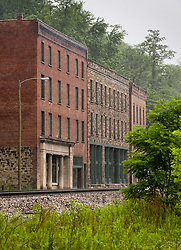 The National Bank of Thurmond (left) and other buildings located in the mostly abandoned town of Thurmond, West Virginia is part of the New River Gorge National River, which is administered by the National Park Service. During the height of coal mining in the New River Gorge, Thurmond was a properous town with banks and other businesses.