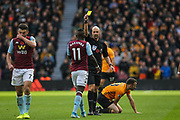 Marvelous Nakamba of Aston Villa receives a yellow card during the Premier League match between Wolverhampton Wanderers and Aston Villa at Molineux, Wolverhampton, England on 10 November 2019.