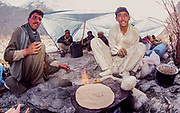 Making chappatis on hot plate over fire, Baltoro glacier, winter, en route ski expedition K2, Pakistan
