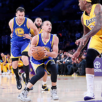 11 April 2014: Golden State Warriors guard Stephen Curry (30) eyes the basket during the Golden State Warriors 112-95 victory over the Los Angeles Lakers at the Staples Center, Los Angeles, California, USA.