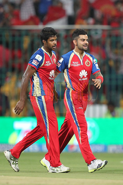 Varun Aaroon and Virat Kohli Captain of the Royal Challengers Bangalore celebrates wicket of Shikhar Dhawan Captain of Sunrisers Hyderabad during match 24 of the Pepsi Indian Premier League Season 2014 between the Royal Challengers Bangalore and the Sunrisers Hyderabad held at the M. Chinnaswamy Stadium, Bangalore, India on the 4th May  2014Photo by Prashant Bhoot / IPL / SPORTZPICSImage use subject to terms and conditions which can be found here:  http://sportzpics.photoshelter.com/gallery/Pepsi-IPL-Image-terms-and-conditions/G00004VW1IVJ.gB0/C0000TScjhBM6ikg