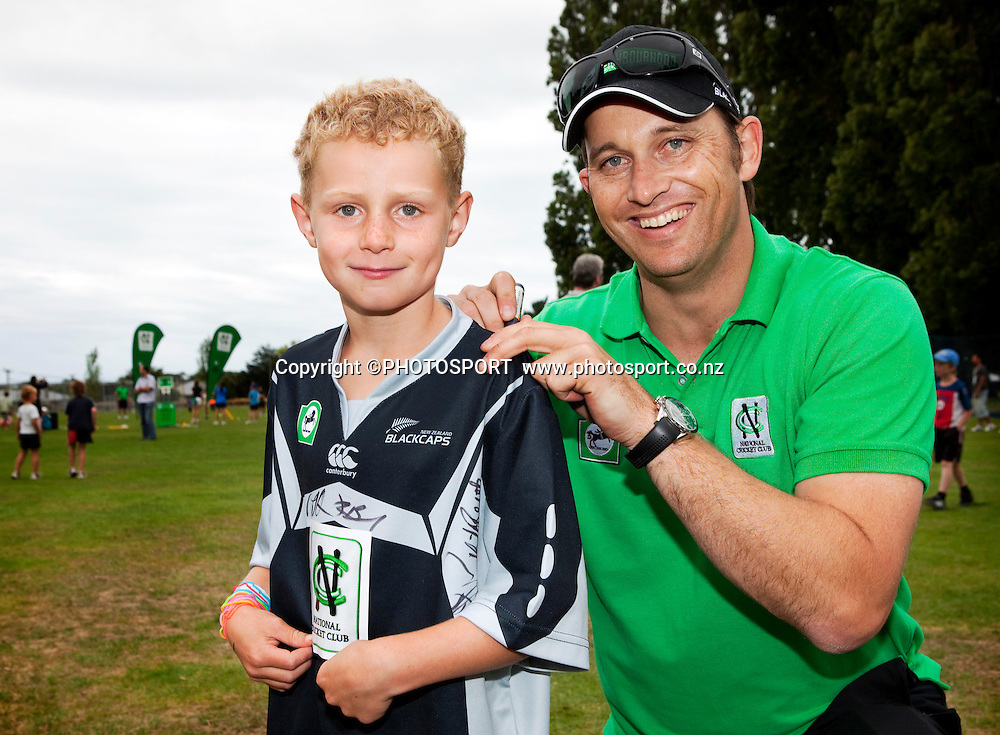 Shane Bond signs his autograph for Cooper Goldsmith (7) during the National Bank Super Camp, a National Bank initiative to connect with cricket's grass roots. Held at the East Shirley Cricket Club, Christchurch, New Zealand. Thursday, 27 January 2011. Joseph Johnson / PHOTOSPORT.