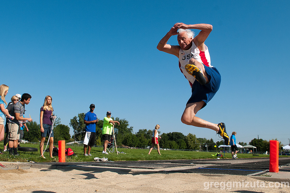 William Platts long jumps to a world record during Idaho Senior Games at Timberline High School in Boise, Idaho on August 3, 2013. Platts finished first in the M85 Division with a jump of 11-07.50.<br /> <br /> Platts holds the Senior World Record in the long jump Men 80-84 Division with a mark of 11-11.75 set in 2009. His jump of 11-07.50 exceeded the current world record in the M85-89 Division of 11-03.00 set by Ralph Maxwell of Richville, Minnesota in 2005.