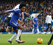 Chelsea attacker Willian fights off Everton midfielder Gareth Barry during the Barclays Premier League match between Chelsea and Everton at Stamford Bridge, London, England on 16 January 2016. Photo by Andy Walter.