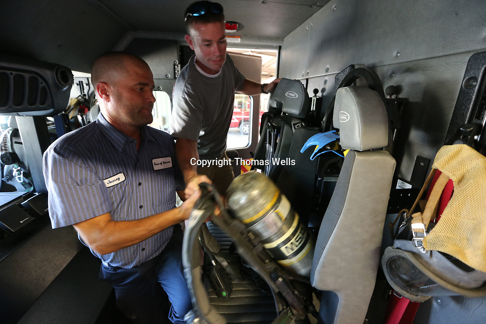 Shannon Volunteer Firemen Jamey Burrow, left, and Chris Estes put new air tanks in the seats of their new firetruck to get it ready for another call. The new truck has helped lower the city's fire rating since it's purchase in 2015.