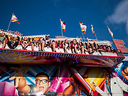 "14 AUGUST 2019 - DES MOINES, IOWA: The ""Crazy Dance"" ride at the Iowa State Fair. The Iowa State Fair is one of the largest state fairs in the U.S. More than one million people usually visit the fair during its ten day run. The 2019 fair run from August 8 to 18.                PHOTO BY JACK KURTZ"