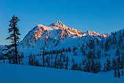 Mount Shuksan, a 9,131-foot (2,783-meter) mountain located in the North Cascades of Washington state, is covered in fresh snow on a cold winter day.