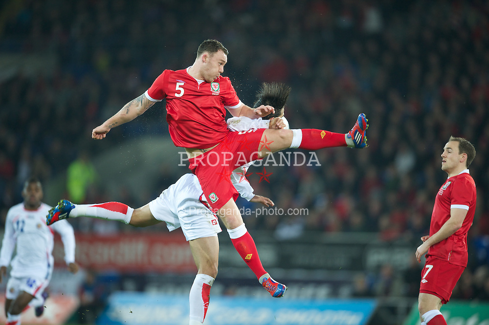 CARDIFF, WALES - Wednesday, February 29, 2012: Wales' Darcy Blake in action against Costa Rica's Bryan Ruiz during the international friendly match at the Cardiff City Stadium. (Pic by David Rawcliffe/Propaganda)