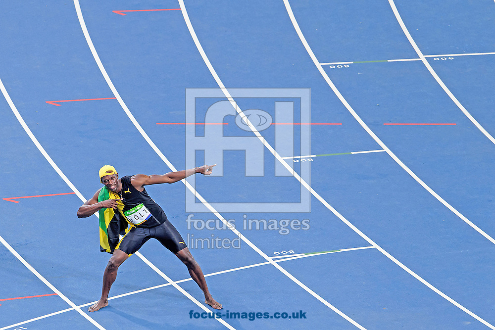 Usain Bolt of Jamaica retains his title and wins his third successive Gold Medal in the Men's 100m on day nine of the XXXI 2016 Olympic Summer Games in Rio de Janeiro, Brazil.<br /> Picture by EXPA Pictures/Focus Images Ltd 07814482222<br /> 14/08/2016<br /> *** UK &amp; IRELAND ONLY ***<br /> <br /> EXPA-EIB-160815-0065.jpg