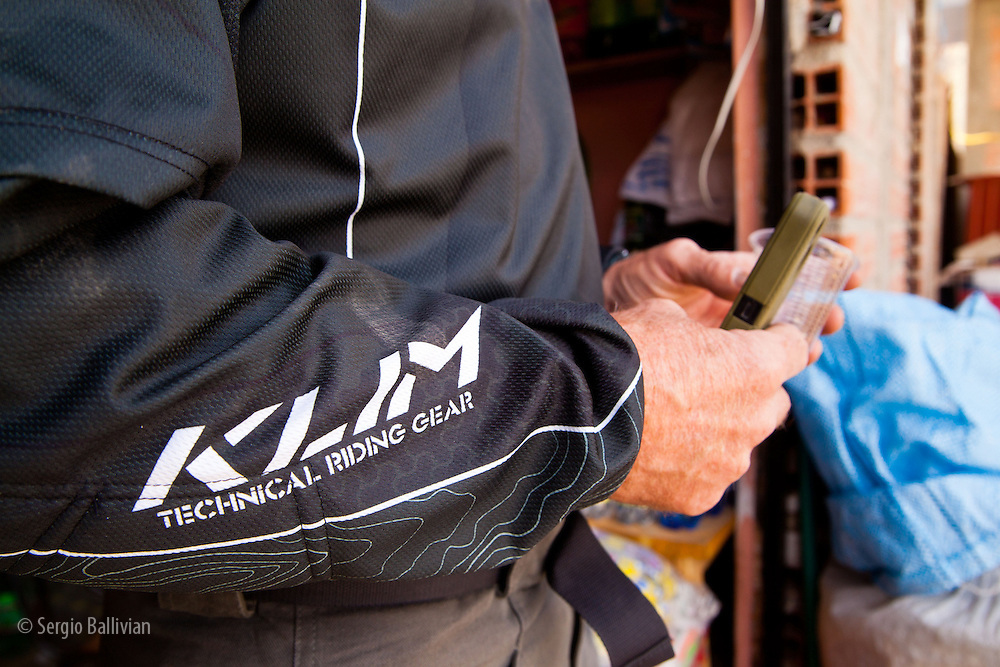 Bill Dragoo holds his iPhone, ready for action in the Cordillera Quimsa Cruz, Bolivia.
