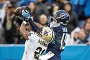 NASHVILLE, TN - DECEMBER 22:  Patrick Robinson #21 of the New Orleans Saints knocks away a pass in the end zone on fourth down thrown to Tajae Sharpe #19 of the Tennessee Titans in the second half at Nissan Stadium on December 22, 2019 in Nashville, Tennessee. The Saints defeated the Titans 38-28.  (Photo by Wesley Hitt/Getty Images) *** Local Caption *** Patrick Robinson; Tajae Sharpe