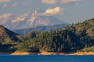 Mount Shasta (volcano) rises above Shasta Lake, Shasta County, California