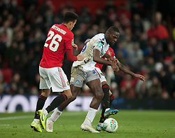 Frank Nouble of Colchester United (C) in action - Mandatory by-line: Jack Phillips/JMP - 18/12/2019 - FOOTBALL - Old Trafford - Manchester, England - Manchester United v Colchester United - English League Cup Quarter Final