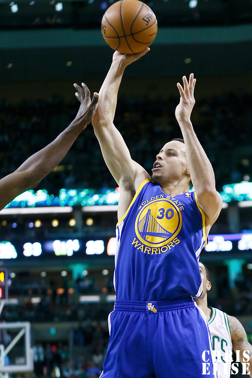 01 March 2013: Golden State Warriors point guard Stephen Curry (30) takes a jumpshot during the Boston Celtics 94-86 victory over the Golden State Warriors at the TD Garden, Boston, Massachusetts, USA.