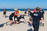 BERGEN - 03-08-2015, strandtraining AZ, strand, AZ trainer John van den Brom (m), AZ speler Thom Haye (r), AZ speler Markus Henriksen (l), AZ speler Aron Johannsson (r).