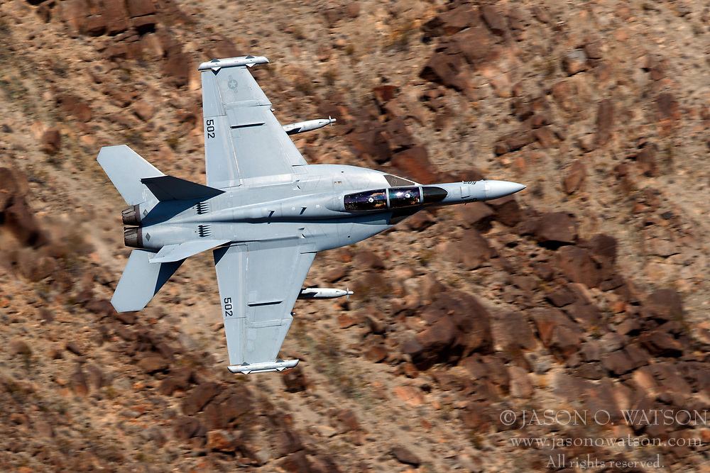United States Navy Boeing EA-18G Growler from the VX-9 Vampires squadron flies low level on the Jedi Transition through Star Wars Canyon / Rainbow Canyon, Death Valley National Park, Panamint Springs, California, United States of America