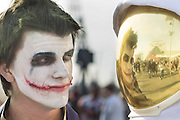 UNITED KINGDOM, London: 24 October 2015 Cosplay fans dressed as The Joker and an astronaut stare each other out on the final day of the MCM London Comic Con at the ExCel Arena in east London. The three day event, which finishes today is said to have brought 130,000 comic con fans and cosplay enthusiasts. Rick Findler / Story Picture Agency
