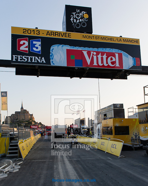 Picture by Andrew McLean Brown/Focus Images Ltd + 33 670 67 8592<br /> 10/07/2013<br /> Just before 7.00am workers prepare the Arriv&eacute;e of stage 11 of the Tour de France, Avranches to Mont-Saint-Michel, France.