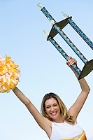 Cheerleader Raising Trophy