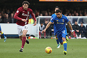 AFC Wimbledon striker Andy Barcham (17) dribbling  during the EFL Sky Bet League 1 match between AFC Wimbledon and Northampton Town at the Cherry Red Records Stadium, Kingston, England on 10 February 2018. Picture by Matthew Redman.