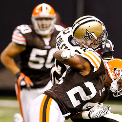 Oct 24, 2010; New Orleans, LA, USA; Cleveland Browns cornerback Sheldon Brown (24) hits New Orleans Saints wide receiver Marques Colston (12) during the second half at the Louisiana Superdome. The Browns defeated the Saints 30-17.  Mandatory Credit: Derick E. Hingle