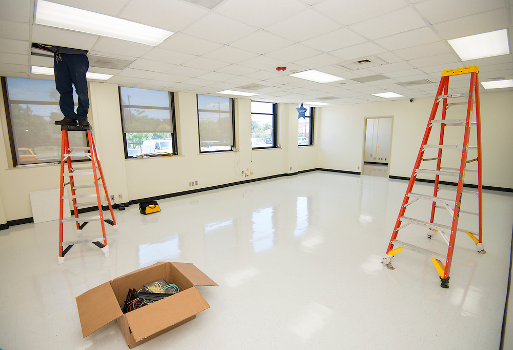 Workmen prepare the Baylor College of Medicine Academy at Ryan for the opening of school, August 13, 2013.