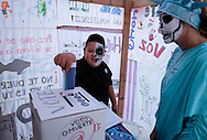 A boy with skull face paint votes at mock poll station during the Day of the Dead celebrations in Los Angeles on Monday, Nov. 1, 2016.(Photo by Ringo Chiu/PHOTOFORMULA.com)<br /> <br /> Usage Notes: This content is intended for editorial use only. For other uses, additional clearances may be required.