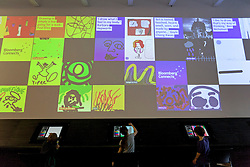 © Licensed to London News Pictures. 19/09/2013. London, UK. Children use touch screens to draw art at the press launch of 'Make Your Mark on Tate Modern' at the gallery in London today (19/09/2013). The new interactive feature allows artists and members of the public to create art and then post it to the on one of the 75 display screens, the created art is then archived by the gallery. Photo credit: Matt Cetti-Roberts/LNP